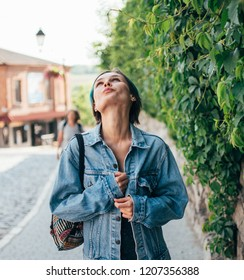 A young woman enjoys a walk through the old historic town.