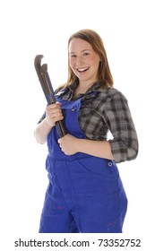 Young woman (Erin Crafts, DIY designer, trainee) with long blond hair wearing a plaid shirt and a blue work overalls. She is holding a large chain wrench his hand. Isolated against a white background.