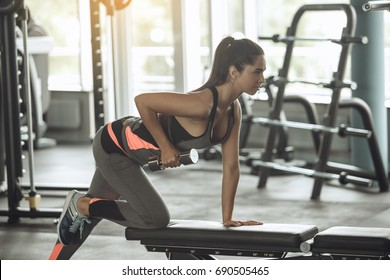 Young woman exercise in the gym healthy lifestyle