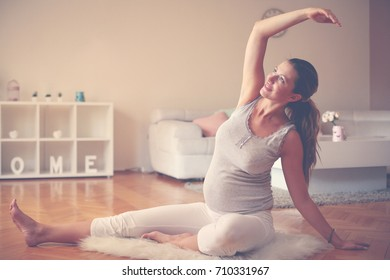 Young woman exercise at home. Woman working exercise.
