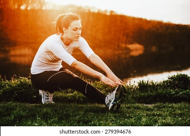 Young woman exercise in nature at the sunrise