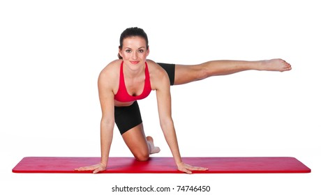 young woman exercise on the floor mat