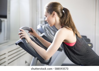 Young woman exercise on the treadmill at the gym