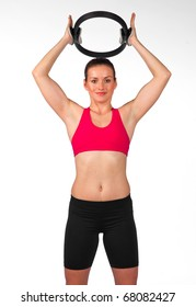 young woman exercise with pilates magic circle