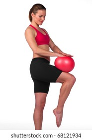 young woman exercise with red soft rubber ball
