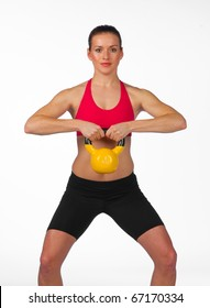 young woman exercise with weights on white background