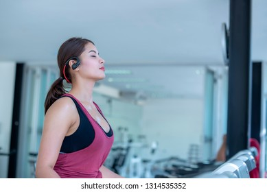 young woman exercise workout in gym fitness breaking relax and healthy lifestyle bodybuilding, cardio workout with machine aerobic for slim and firm healthy, Athlete builder muscles lifestyle.