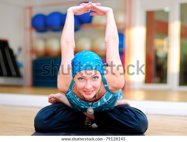 Young woman exercises at yoga class