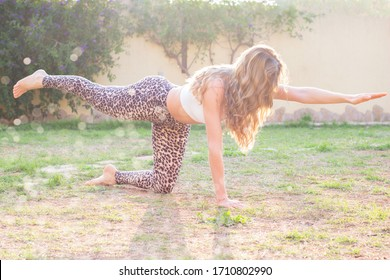 Young woman exercising in back yard outdoors