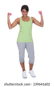 Young Woman Exercising With Dumbbells Over White Background
