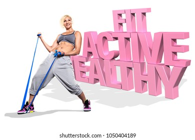 young woman exercising with elastic expander