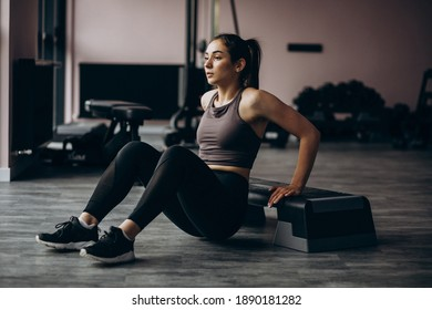 Young woman exercising at the gym with weight