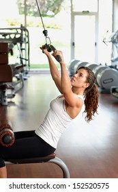 Young woman exercising at the health club