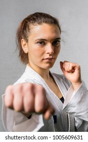 Young woman exercising with karate martial art combat, self defense