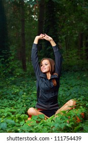 Young woman exercising outside in the forest