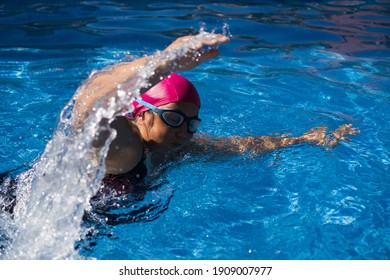 young woman exercising and relaxing in swimming pool outdoor