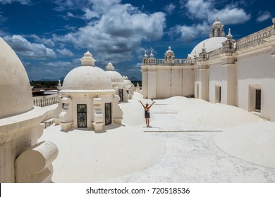 Young woman explores the roof of Leon Cathedral