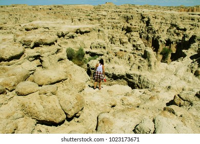 Young woman exploring the Badlands