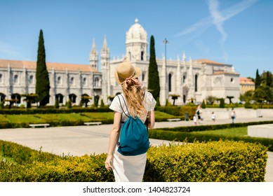 Young woman exploring Belem and it's Hieronymites Monastery from XVI century
