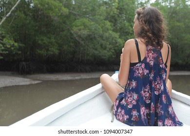 Young woman exploring mangroves on boat safari
