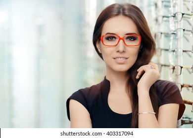 Young Woman with Eyeglasses in Optical Store - Beautiful girl wearing glasses in optician shop
