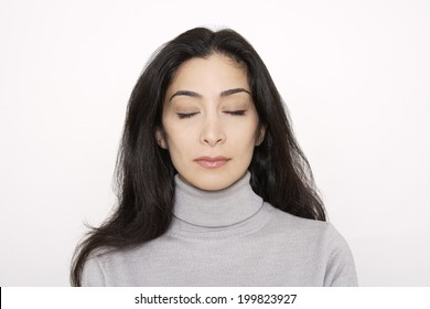 Young woman with eyes closed, portrait