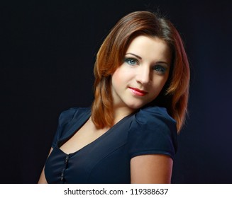 young woman face with clean skin. Bright eye make-up. Black background