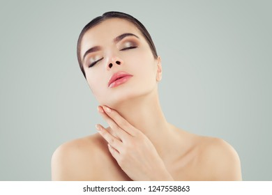Young woman face. Relaxing female model portrait