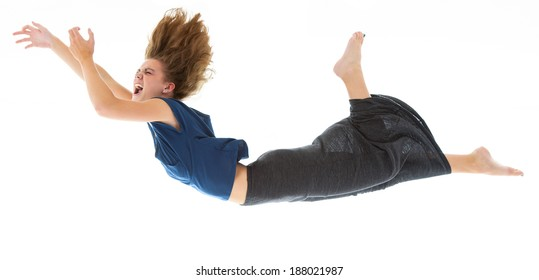 Young Woman Falling and Terrified, Isolated on White Background