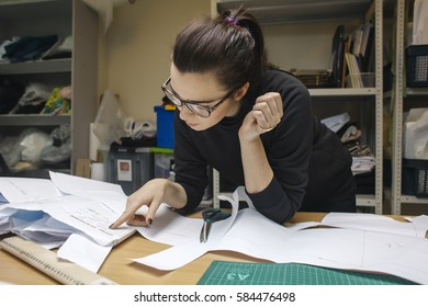 young woman fashion designer working in studio