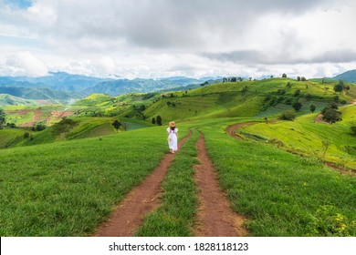 Young woman feel relaxing on green grass mountain