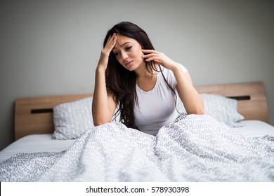 Young woman feel  sick and unwell on bed