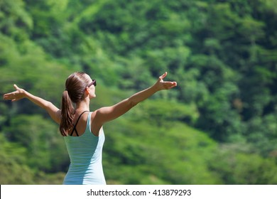 Young woman feeling free enjoying the great outdoors.