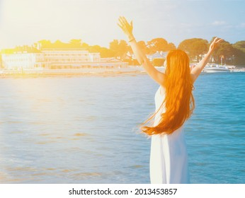 A young woman feels free on the beach in Poole, United Kingdom