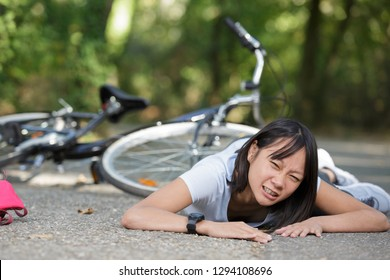 young woman fell off her bike