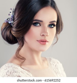 Young Woman Fiancee with Bridal Hairstyle, Natural Makeup and Jewelry