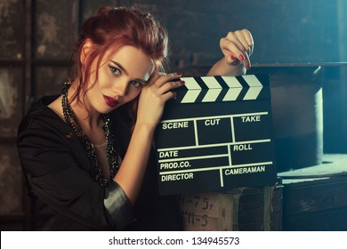 Young woman film director portrait.