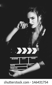 Young woman film director portrait. Film style black and white.