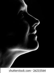 young woman fine-art high-contrast portrait in backlight