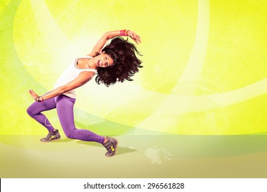 young woman at fitness exercise or aerobics dancing