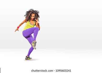 a young woman at fitness exercise or dancing