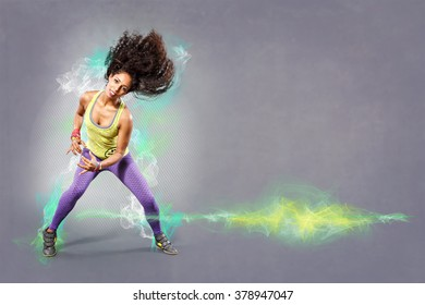young woman at fitness exercise or dancing