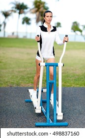 Young Woman Fitness Training on Eliptical in Park
