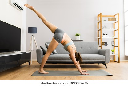 Young Woman In Fitness Wear Doing Exercise At Home
