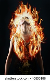 A young woman with flaming hair on a black background. Throws back his head.