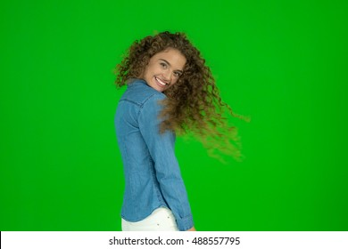 The young woman flirt and stand on the green background