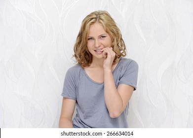 Young woman flirting and biting nails