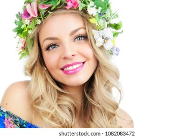 Young woman with flowers crown. Beauty model girl.Beautiful Girl with flowers on her head.spring lady, apple blossoms