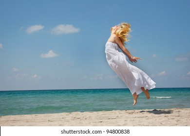 young woman flying on sea background