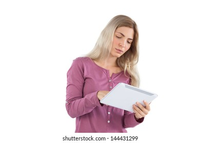 Young woman focused on her tablet pc on a white background